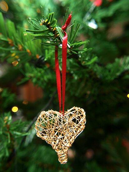 Golden heart ornament hanging by Arve Bettum