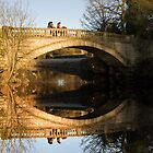 Heavy Horses on bridge reflected on river  by DerekWells