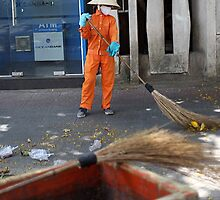 Holiday snaps - street cleaning lady by geof