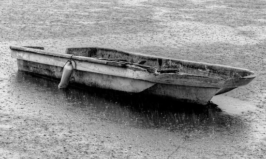 Small boat under a heavy rain in Nassau Harbour, The Bahamas by 242Digital