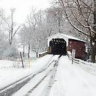 Covered Bridge in Snow by Delmas Lehman