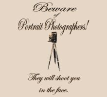 Beware of Portrait Photographers! They will shoot you in the face. by Weber Consulting