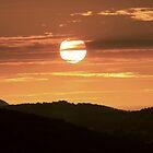 Sunset Over The Tian Tan Buddha by Graham Ettridge
