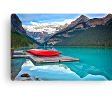 Red Canoes on a Wooden Dock Canvas Print
