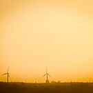 Wind turbines at sunset by Mark Carthy