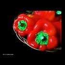 Capsicum Annuum - Sweet Red Bell Peppers In Wicker Basket  by  Sophie Smith