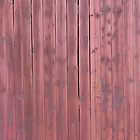 Old red plankd barn wall by Kristian Tuhkanen