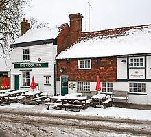 The Cock Inn covered in snow in Ide Hill Kent  by Keith Larby