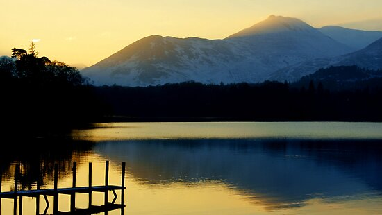 Winter Sunset On Derwent Water by Lou Wilson