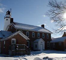 FOrt Gratiot Light house in winter by cherylc1