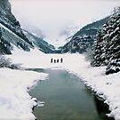 Lake Louise under a snow filled sky by Nancy Richard