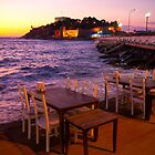 Night restaurant on the beach in Turkey by Kirk D. Belmont Photography