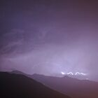 Lightning over french alps by Grace Johnson