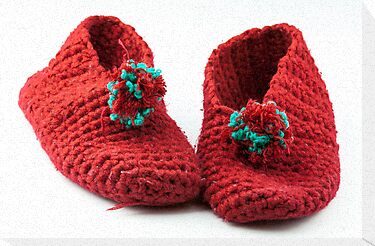 Red knitted slippers by Cebas