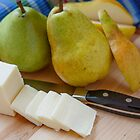 Cut Pear with Whole Pears and Sliced Cheese by dbvirago