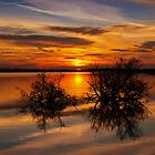 reflection of sunset colors by george papapostolou