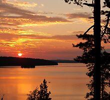 Red sundown over an lake by Kristian Tuhkanen