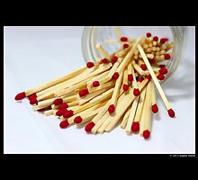 Household Safety Matches Spilled Out Of A Glass Jar by © Sophie W. Smith