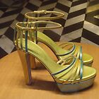 Green, blue and yellow stilettos by Caroline Clarkson