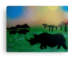Rhinos in the sunset Canvas Print