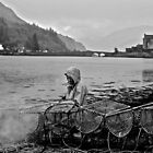 Cleaning Lobster Pots,  Eilen Donan Castle.  by Ross Hutton