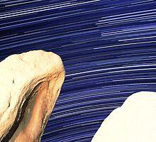 Desert Boulders With Galaxy Star Trails in Background by Gavin Heffernan