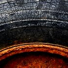 Rusty Old Car Tyre by appfoto