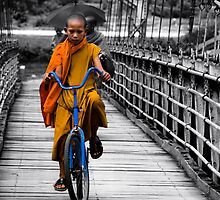 Monk on a blue Bicycle in Laos by johnxmas