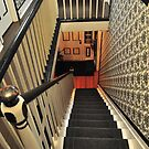 looking down the staircase by deville