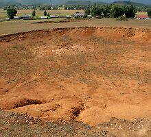 Bomb crater - The Plain of Jars, Laos by Glen O'Malley