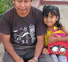 father and daughter in the central park- Ahuachapan, El Salvador by David Chesluk