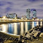 Coastline of Barcelona at night by Michael Abid