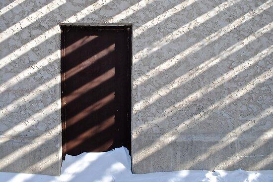 door, shadow and snow  by richard  webb