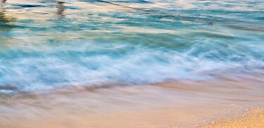 Waves meets sand by Susan Tong