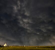 Old Country Church in Saskatchewan Canada with storm clouds rainbow by pictureguy