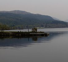 A jetty pushing out into the waters of Loch Ness in Scotland by ashishagarwal74