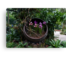 Pink and purple flowers in a slanting container Canvas Print