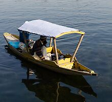 2 Kashmiri men in a small boat in the Dal Lake in Srinagar by ashishagarwal74