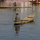 Kashmiri men rowing many small wooden boats by ashishagarwal74
