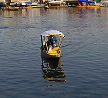 2 Kashmiri men in a small wooden boat in the Dal Lake in Srinagar by ashishagarwal74