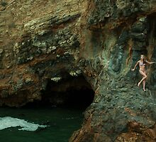 Bikini model posing in front of volcano crater in Palos Verdes, CA by Anton Oparin