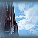 Manufacturing Clouds on Commerce St. by Deb  Badt-Covell