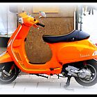 Orange Vespa by ©The Creative  Minds