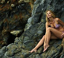 Bikini model posing in front of rocks in Palos Verdes, CA II by Anton Oparin