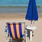 Closed Blue Beach Umbrella with Chair by jojobob
