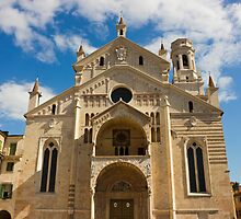 Verona Cathedral facade over blue sky with white clouds by kirilart