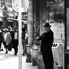 Violin player busking in the streets of Liège by madebykarl