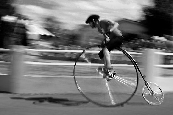 Penny Farthing race blur by Cecily  Graham