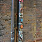 Sticker-covered Drainpipe in Siena, Italy by will897