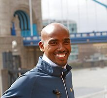 Mo Farah by Tower Bridge ahead of the Virgin London Marathon 2013 by Keith Larby